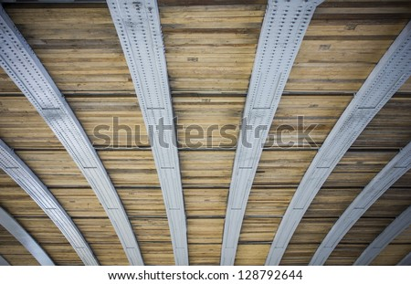 Curved steel bars and wooden planks pattern/Pattern/architecture detail