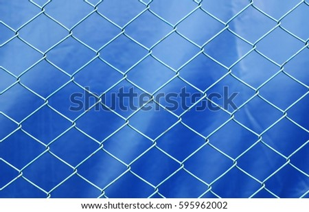 Curved steel on a blue background, steel cage #595962002