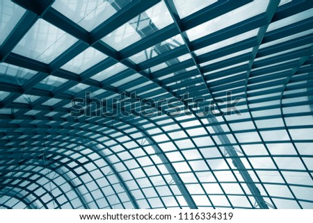Curvilinear grid structure. Metal framework with structural glazing. Tilt close-up photo of modern architecture fragment. Abstract architectural or industrial background in hi-tech style. #1116334319
