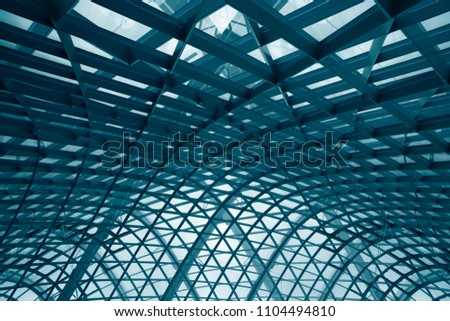 Curvilinear grid structures. Metal framework with structural glazing. Double exposure photo of modern architecture fragment. Abstract architectural or industrial background in hi-tech style. #1104494810