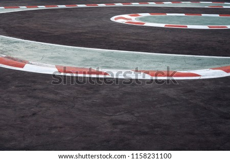 Curving asphalt red and white kerb of a race track detail,Motorsports racing circuit Race track curve road for car racing #1158231100