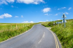 Curving Country Road in Cornwall on Clear Spring Day