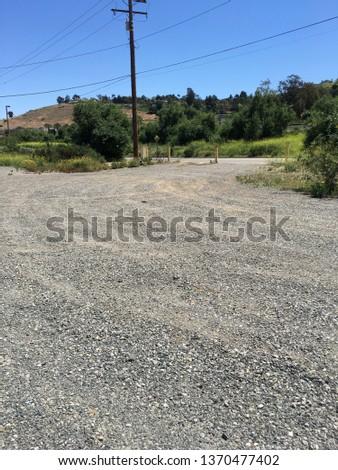 Curving gravel road in Corona, CA. #1370477402