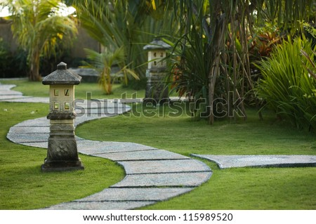 Curving traditional garden path in Bali, Indonesia