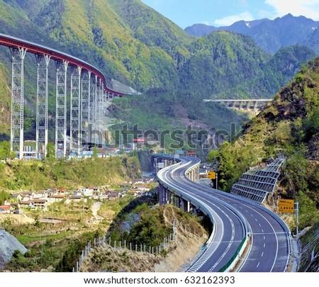 Curvy Highway,Bridge - Built Structure, Built Structure, Famous Place, Highway, Springtime #632162393