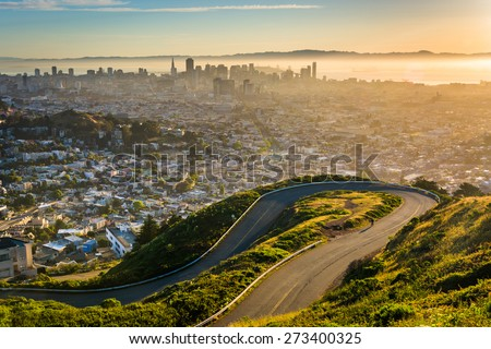 Curvy road and view of downtown at sunrise from Twin Peaks, in San Francisco, California. #273400325