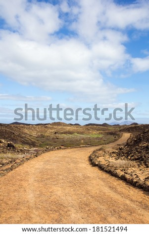 Curvy trail on the small island of Los Lobos, near Fuerteventura, in the Canary Islands, Spain.