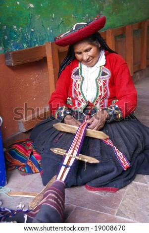 CUSCO PERU AUG 2008 - Quechua Indian woman weaving with strap loom, Cusco,Peru, South America