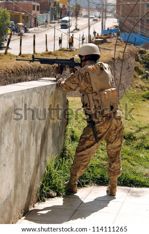 CUSCO, PERU - JULY 19: Peruvian soldier in defense position during the military exercises on July 19, 2012 in Cusco, Peru.