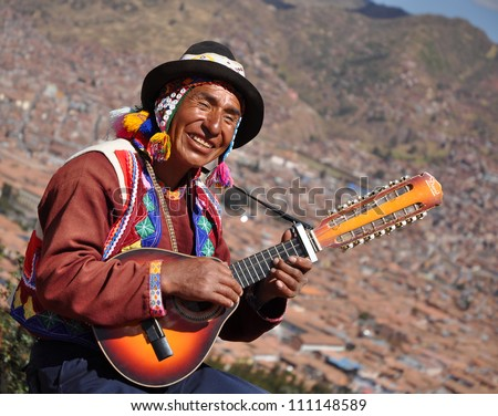 CUSCO, PERU- JUNE 16: Quechua Indian man performs in Cusco, Peru on June 16 2012, Quechua are known worldwide for their traditional and colourful outfit.