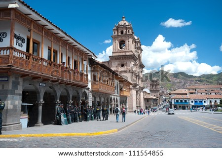 CUSCO, PERU - MAY 6: Police watch Festvial Participants in Cusco's weekly (Sunday) parade in the Plaza de Armas.