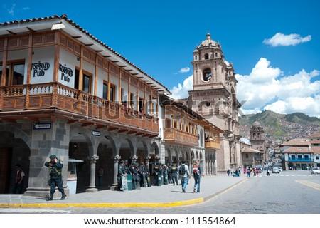 CUSCO, PERU - MAY 6: Police watch Festvial Participants in Cusco's weekly (Sunday) parade in the Plaza de Armas.