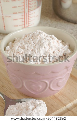 Custard Powder a cornflour based powder which when mixed with hot milk produces an egg free custard sauce