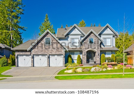 Custom built big luxury house with triple doors garage in a residential neighborhood. Suburbs of Vancouver ( Surrey ) Canada.