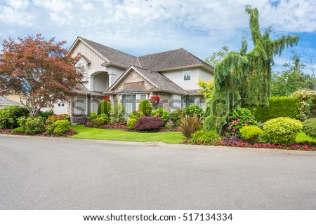 Custom Built Luxury Homes With Nicely Trimmed And Designed Front Yard, Lawn  In A Residential