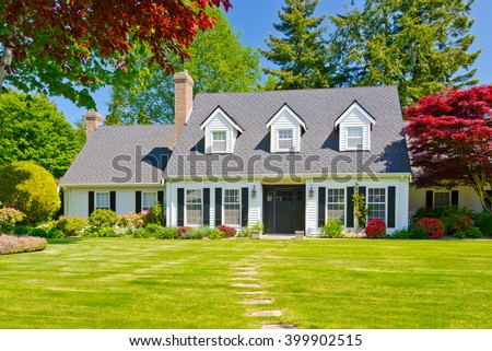 Custom built luxury house with nicely trimmed and landscaped front yard, lawn in a residential neighborhood. Vancouver Canada. #399902515