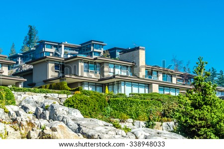Custom built luxury modern house on the cliff, rock  in a residential neighborhood. Vancouver Canada.