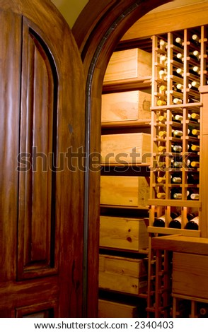 custom built mahogany door entry to wine cellar private mansion house residence