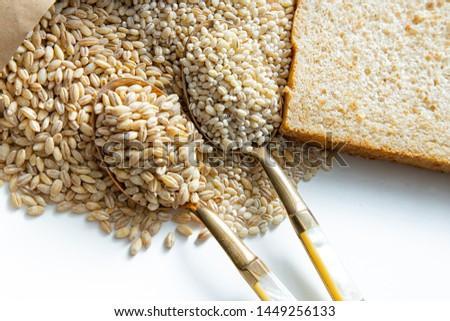 Custom made bread. Show many types of whole grain ingredients. Barley and pearl barley. White background