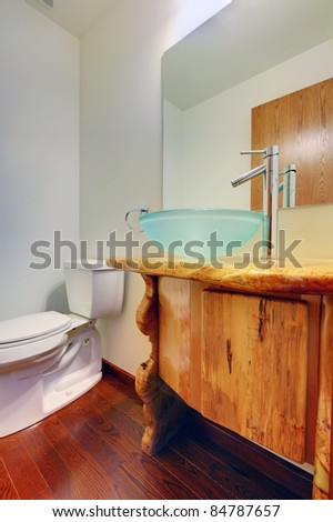 Custom wood cabinet with blue sink
