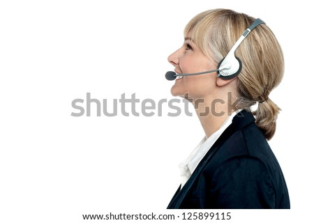 Customer are executive engaged in jovial conversation, side profile. Copy space area on image.