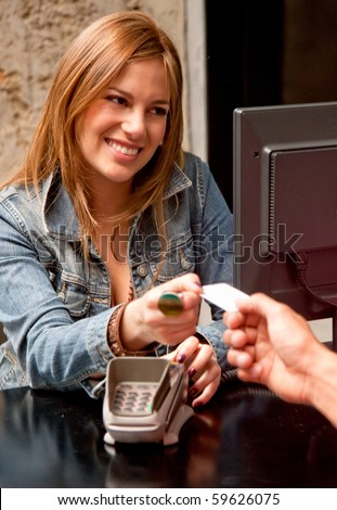 Customer at the till paying by debit or credit card