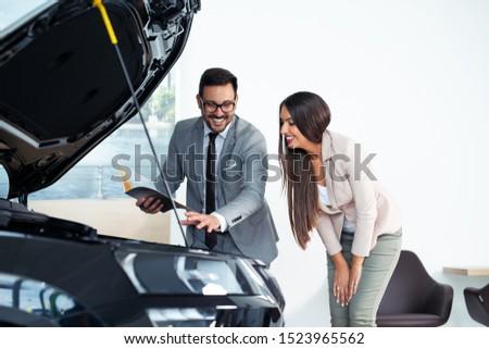 Customer buying a vehicle at car dealership #1523965562