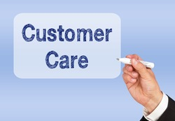 Customer Care - Businessman writing text with pen on blue background