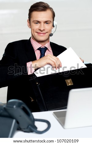 Customer care person arranging office documents. Sitting in office