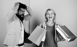 customer decision. man angry woman shopaholic. gift packages for holiday preparation. seasonal discount. black friday. shop closeout. family couple go shopping. impulse purchase. couple of shoppers.