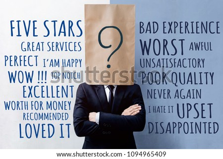 Customer Experience Concept, Businessman Client with Question Mark Icon on Paper Bag, Crossed arms and wearing Suit. Concrete Wall with Wording of Positive and Negative Reviews #1094965409