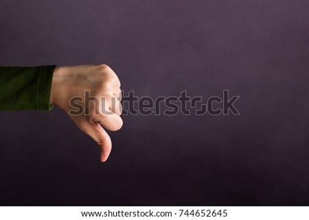 Customer Experience Concept, Hand of Client show Bad sign with Thumb down for Rating in Satisfaction Survey, Symbol of Meaning