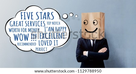 Customer Experience Concept. Happy Businessman Client with Smiley Emotion Face on Paper Bag, Crossed arms and looking at Wording of Positive Reviews on Think Bubble #1129788950