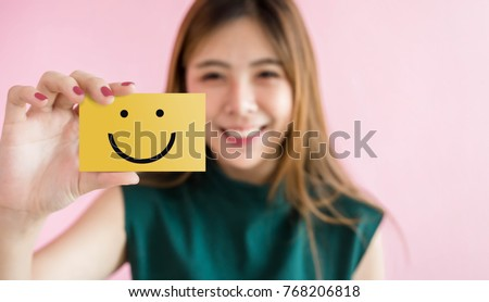 Customer Experience Concept, Happy Woman Show Excellent Rating with Smiley Face icon for her Satisfaction on Card