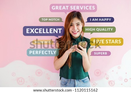 Customer Experience Concept. Happy Young Woman using Smart Phone to Read or Feedback her Satisfaction Online Survey. Surrounded by Social Icons and Positive Review in Speech Bubble #1120115162