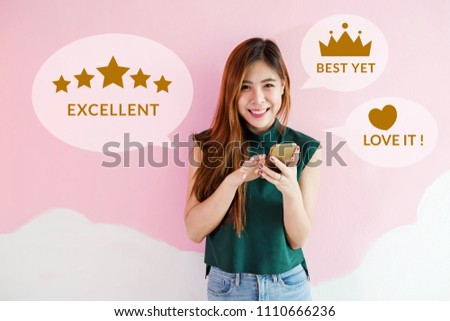 Customer Experience Concept. Happy Young Woman using Smart Phone to Review and Feedback Rating in Online Satisfaction Survey Application. Looking at camera with Smile #1110666236