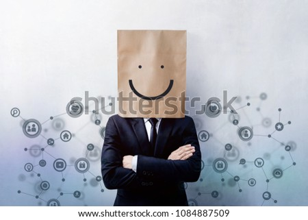 Customer Experience Concept, Portrait of Happy Businessman Client with Smiley Face Emotion on Paper Bag, Crossed arms and wearing Suit, Standing at the Wall with Social Network Icons