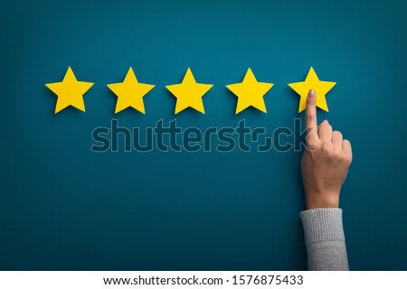Photo of  Customer Experience Concept. Woman hand showing on five star excellent rating on background, copy space