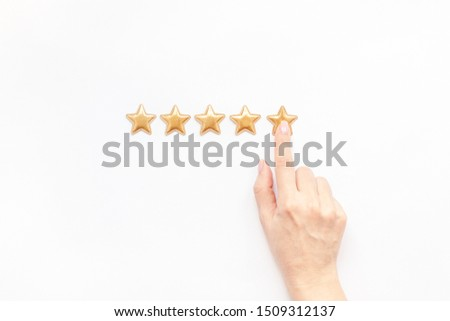 Customer Experience Feedback Concept. Golden five 5 stars, best excellent services rating with woman hand for satisfaction isolated on white background. Top view, copy space for your text