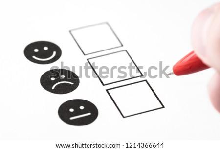 Customer experience survey, employee feedback questionnaire or business poll concept. Happy smile, neutral and sad frown faces on paper. Multiple choice research form with check box in psychology. #1214366644