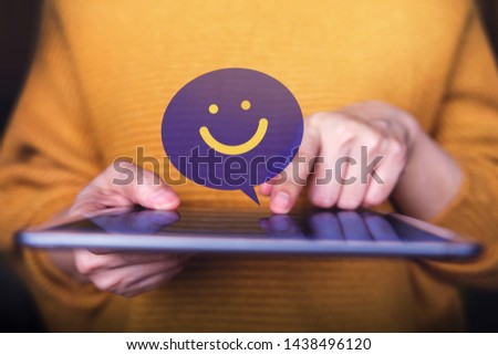 Customer Experiences Concept. Happy Client using Digital Tablet to Sending a Positive Review. Satisfaction Online Survey