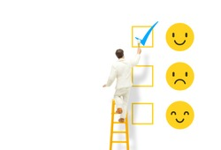 Customer Feedback Concept : Painter standing on ladder and painting blue tick checkbox on face emotions in happiness symbol for best service ranking.