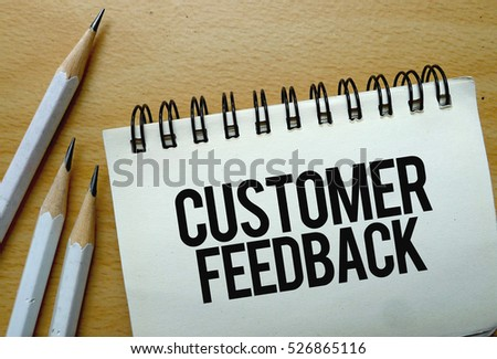 Customer Feedback text written on a notebook with pencils #526865116