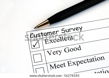 Customer fills in the feedback survey - stock photo