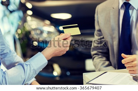 customer giving credit card to car dealer in salon #365679407