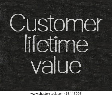 customer lifetime value written on blackboard background high