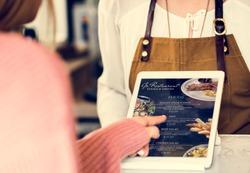 Customer ordering food at restaurant counter