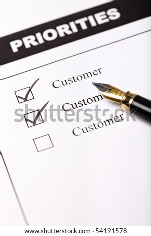 Customer oriented business concept with questionnaire and pen