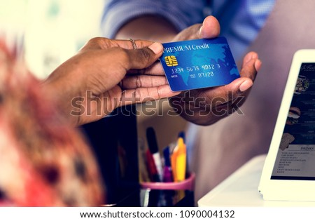 Customer paying for bakery products by credit card