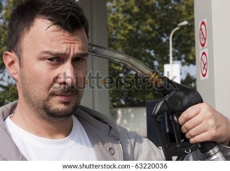 Customer Refilling Car at Gas Station - stock photo